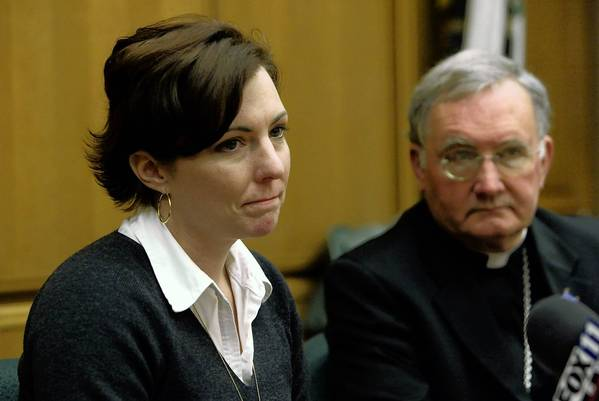 Thomas Hodgman sexual abuse victim Joelle Casteix speaks out at a press conference as Bishop Todd Brown from the Orange Diocese looks on.