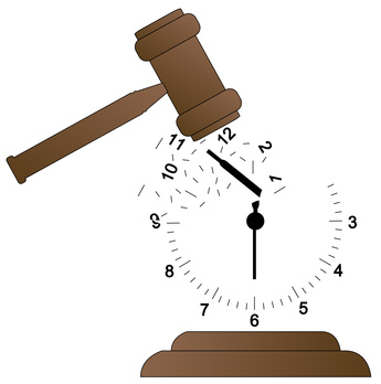 gavel smashing clock and scattering it - time concept